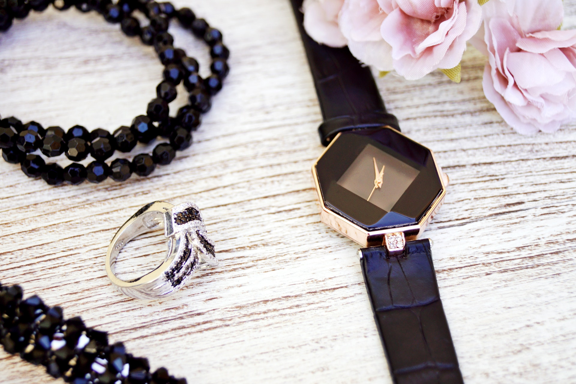black-and-gold-colored-analog-watch-with-leather-strap